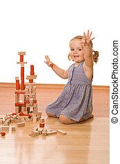 vrolijke , klein meisje, met, houten blokken
