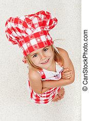 vrolijke , kleine chef, meisje, kijkend, en, het glimlachen