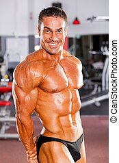 vrolijke , mannelijke , bodybuilder, flexing spier