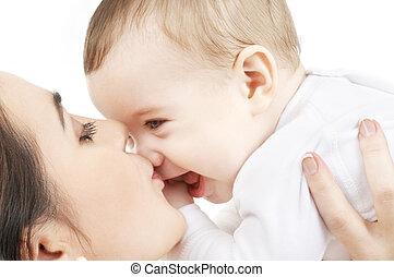 vrolijke , moeder, kussende , baby jongen