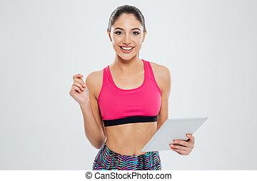 vrolijke , sporten vrouw, gebruik, tablet, computer