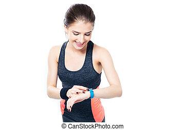 vrolijke , sportief, vrouw, gebruik, smartwatch