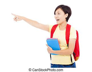 vrolijke , student, meisje, vasthouden, boekjes , en, wijzende