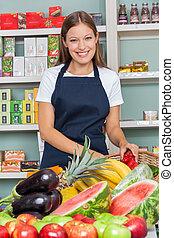 vrolijke , verkoopster, werken aan, supermarkt
