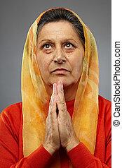 vrouw bidden, oud