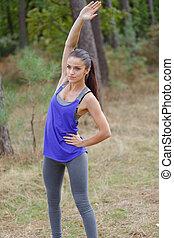 vrouw, buiten, stretching