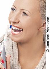 vrouw, closeup, poetsen, kaukasisch, gezicht, blonde , teeth, elektrisch