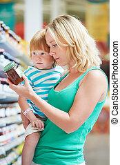 vrouw, en, jongen, vervaardiging, shoppen
