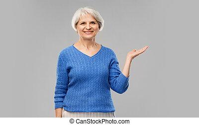 vrouw, hand, iets, vasthouden, senior, lege