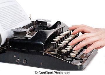 vrouw, handen, het typen, op, ouderwetse , typemachine, vrijstaand, op wit