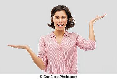 vrouw, hemd, jonge, iets, vasthouden, gestreepte