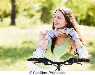 vrouw, het berijden van een fiets