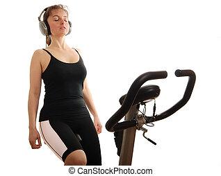 vrouw, het luisteren, muziek, op, het spinnen, fiets