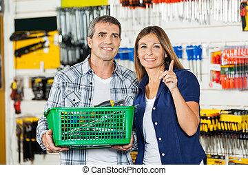 vrouw, het tonen, hardware, iets, winkel, man
