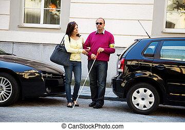 vrouw, hulp, blinde man, op de straat