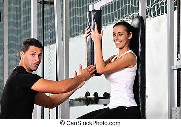 vrouw, in, de, fitness, gim, het uitwerken, met,...