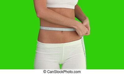 vrouw, in, sportkleding, controleren, haar, gewicht