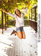 vrouw, jonge, springt