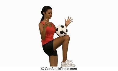 vrouw, juggling, een, voetbal, op wit