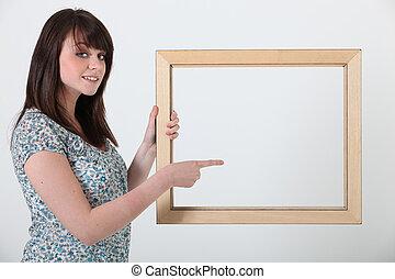 vrouw, met, een, fotolijst