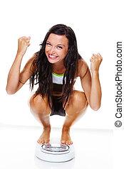 vrouw, met, schalen, na, een, succesvolle , dieet