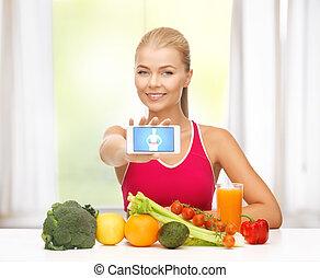 vrouw, met, vruchten, groentes, en, smartphone