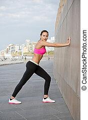 vrouw, muur, stretching, jonge, tegen, graniet