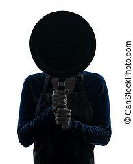 vrouw, silhouette, het koken, achter, koekenpan, het verbergen
