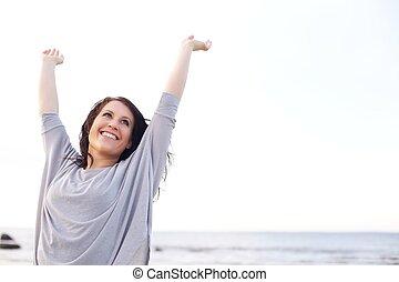 vrouw, verheffing, en, stretching, haar, armen