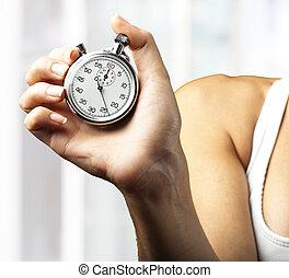 vrouw, voortvarend, stopwatch