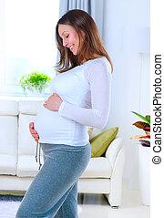 vrouw, vrolijke , jonge, home., zwangerschap, zwangere