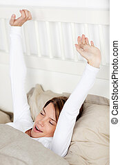 vrouw, yawning, en, stretching, haar, armen