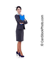 vrouw zaak, klembord, staand, haar