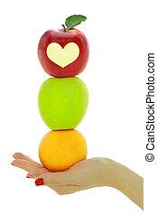 vrouwelijke hand, met, stapel, van, fris, kleurrijke, vruchten, vrijstaand
