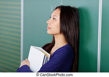 vrouwelijke student, in, gedachten