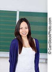 vrouwelijke student, in, klaslokaal