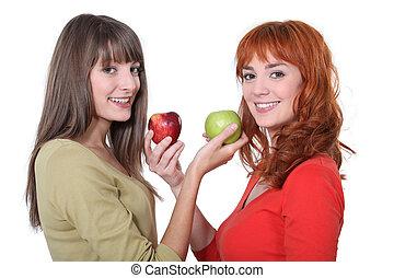 vrouwen, appeltjes , vasthouden, twee