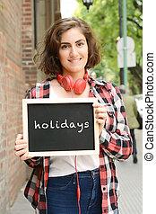 """vrouwenholding, chalkboard, met, """"holidays""""."""