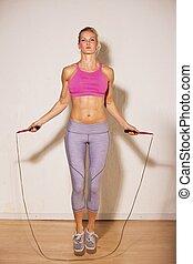 vrouwlijk, atleet, doen, haar, sterkte opleiding
