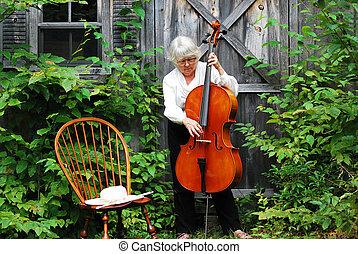 vrouwlijk, cellist.