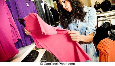 vrouwlijk, de winkel van kleren