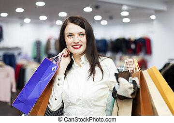 vrouwlijk, klant, op, kleding, boutique
