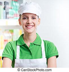 vrouwlijk, omzet beamte, werken aan, supermarkt