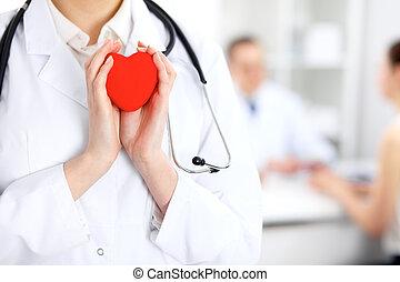vrouwtje arts, met, stethoscope, vasthouden, heart.