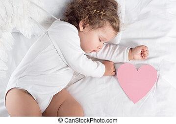 vue dessus, de, peu, chérubin, à, ailes, coucher lit, à, coeur