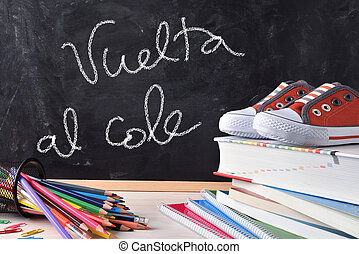 Vuelta al cole written on blackboard and tools front
