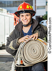 wąż gumowy, strażak, ogień stacja, dzierżawa, szczęśliwy