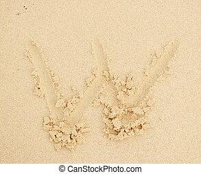 w letter written in the sand