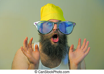 Wacky Excited Bearded Man - A wacky bearded man hoots in...