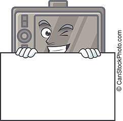 Wacom cartoon character with funny face hides behind a board